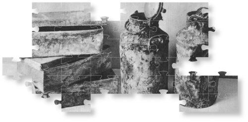 Puzzleteile von Metallboxen und Milchkannen, in denen das Archiv des Warschauer Ghettos